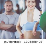 beautiful woman at the gym... | Shutterstock . vector #1305558403