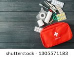 first aid kit on wooden... | Shutterstock . vector #1305571183