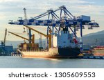 container ship is loading in a... | Shutterstock . vector #1305609553