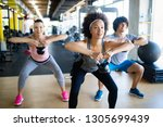 group of healthy fit people... | Shutterstock . vector #1305699439