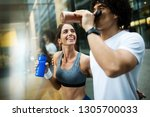 couple jogging and running... | Shutterstock . vector #1305700033