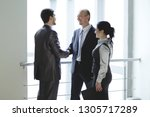 smiling business team looking... | Shutterstock . vector #1305717289