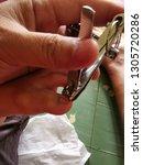pedicure at home  parents cut... | Shutterstock . vector #1305720286