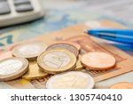 a calculator with euro bills... | Shutterstock . vector #1305740410
