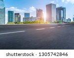highway road and skyline of... | Shutterstock . vector #1305742846