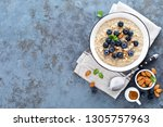 oatmeal with fresh raw... | Shutterstock . vector #1305757963