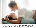 happy girl and man hugging near ... | Shutterstock . vector #1305788683