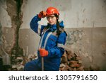 Destroying gender stereotypes. Woman wearing helmet using different male work tools. Gender equality. Girl working at flat remodeling. Building, repair and renovation. woman in the male profession - stock photo