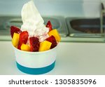ice cream in a paper cup with... | Shutterstock . vector #1305835096
