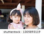 beautiful asian mother and cute ... | Shutterstock . vector #1305893119