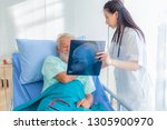 the doctor is diagnosing the... | Shutterstock . vector #1305900970