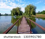 wood bridge to the island | Shutterstock . vector #1305901780