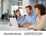 coworkers sitting at table and... | Shutterstock . vector #1305922120