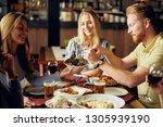 friends having dinner at... | Shutterstock . vector #1305939190