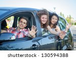 boys and girls in a car leaving ... | Shutterstock . vector #130594388