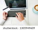 beautiful young woman using... | Shutterstock . vector #1305949609
