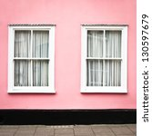 A Pink House With White Windows ...