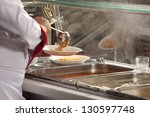 chef standing behind full lunch ...   Shutterstock . vector #130597748