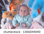 little baby in the swing.... | Shutterstock . vector #1306044040
