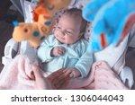 little baby in the swing.... | Shutterstock . vector #1306044043