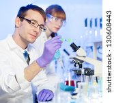 young male researcher looking... | Shutterstock . vector #130608443