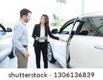 pretty salesperson opening... | Shutterstock . vector #1306136839