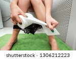 the girl sitting on the toilet...   Shutterstock . vector #1306212223