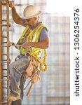 male construction worker... | Shutterstock . vector #1306254376