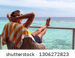 boy taking a sunbath in the... | Shutterstock . vector #1306272823