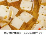 feta cheese in oil with spices | Shutterstock . vector #1306289479