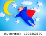 little baby superhero with red... | Shutterstock . vector #1306363870