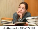 cute girl child with stacks of... | Shutterstock . vector #1306377190