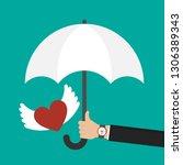 businessman hand holding an... | Shutterstock .eps vector #1306389343