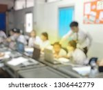 blurred image of group of... | Shutterstock . vector #1306442779