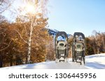 snowshoes in the snow on the... | Shutterstock . vector #1306445956
