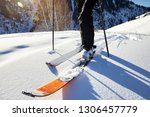 man skiing on fresh powder snow ... | Shutterstock . vector #1306457779