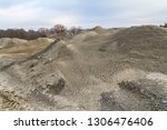 spoil heap scenery at a quarry... | Shutterstock . vector #1306476406