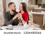 young and happy couple talking... | Shutterstock . vector #1306480066