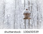 Wooden Birdhouse Covered With...