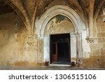 entance of the church of abbey... | Shutterstock . vector #1306515106