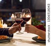 hands holding glasses of wine... | Shutterstock . vector #1306518043
