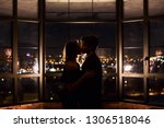 couple in love kissing on... | Shutterstock . vector #1306518046