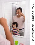child with dad learn how to...   Shutterstock . vector #1306551979