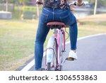 asian girl cycling on street...   Shutterstock . vector #1306553863