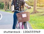 lady riding bicycle on street...   Shutterstock . vector #1306555969