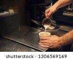barista preparing fresh... | Shutterstock . vector #1306569169