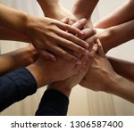 people putting hands together ... | Shutterstock . vector #1306587400