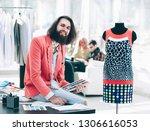 portrait of a fashion designer... | Shutterstock . vector #1306616053