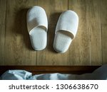 white slippers on the floor by... | Shutterstock . vector #1306638670