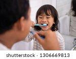 happy kid and dad having fun... | Shutterstock . vector #1306669813
